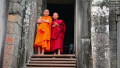 Siem reap, cambodia - circa dec 2013: two child monks in traditional robes ar Stock Footage