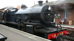 Steam train at Bishops Lydeard station and  Somerset Stock Footage