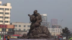 Man hugging a women statue China Stock Footage