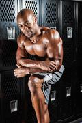 Portrait of a lean toned and fit muscular man under dramatic low key lighting Stock Photos
