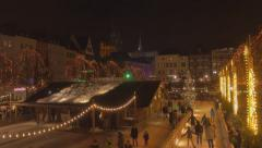 Panning total shot of German Christmas market, night time Stock Footage