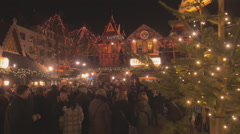 Christmas market in Cologne, Germany, panning shot in night time Stock Footage