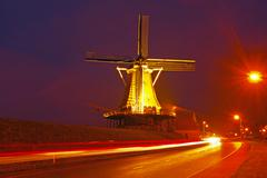 Traditional windmill in the countryside at night in the netherlands Stock Photos