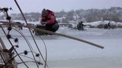 Fisherman fishing Winter Ice River 4k Stock Footage