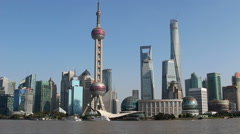 Huangpu river flowing along Pudong financial district Stock Footage