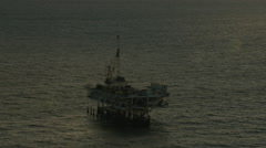 Aerial Exploration Platform drilling Rig sunset Oil USA Stock Footage