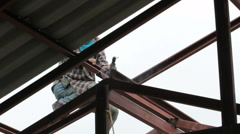 Welder at work on the roof - stock footage