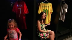 Fans taking pictures with Neymar Brazilian tshirt in Maracana Stock Footage