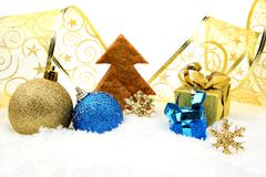 Decoration of golden and blue christmas baubles and gifts with ribbon with wi Stock Photos