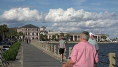 People walk along e. battery boardwalk, charleston, sc, usa Stock Footage