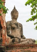 Stock Photo of buddha statue in meditate bhumisparsha mudra posture