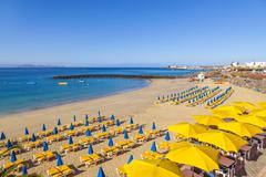 beach of playa blanca without people in early morning - stock photo