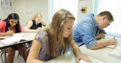 Students doing their assignments/homework in class. Ultra HD 4K - stock footage