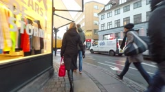 Following the lady with the red bag Stock Footage