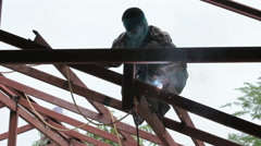 Welder at work on the roof Stock Footage