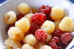Raspberry on the plate close up after harvest Stock Photos