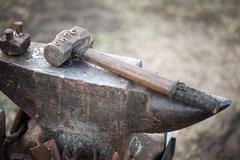 hammer on blacksmith anvil - stock photo