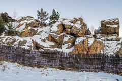 Rocks in the winter in the mountains of the urals Stock Photos