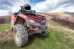 Atv on mountains landscape on a sunny day Stock Photos