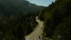 Aerial view motorists driving on the winding road Stock Footage
