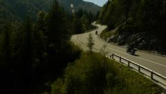 Aerial view group of motorists riding on the winding road - stock footage