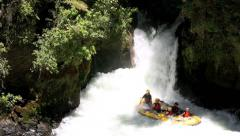 Whitewater rafting over a waterfall Stock Footage
