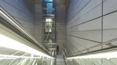 An escalator is moving people between floors in the metro station Stock Footage