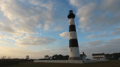 Clouds move behind the bodie island lighthouse Stock Footage
