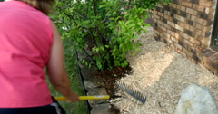 Woman working in garden in the summer time. Ultra HD 4K Stock Footage