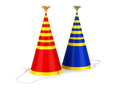 two colored stripped birthday caps isolated on white background - stock illustration