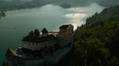 Aerial view of castle on Lake Bled. - stock footage