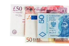 banknotes of 50 pounds euro and polish zloty - stock photo