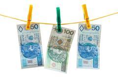 polish zloty banknotes on clothesline - stock photo