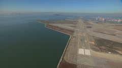 Aerial Alameda Naval Air Station coastal airport USA Stock Footage