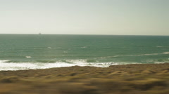 Traveling on a train, looking out window viewing beach & waves-30 Stock Footage