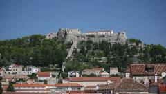 Ancient fortress at Hvar island over town citadel Stock Footage