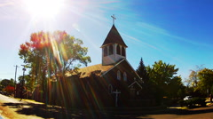 Old Fashioned Small Town Catholic Church With Sun Flare Stock Footage