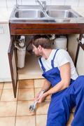 Handyman under the sink Stock Photos