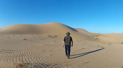 Man Walks Away From Camera In Sandy Desert- Glamis CA Stock Footage