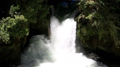 Two kayaks paddle over the Okere Falls Stock Footage