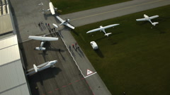 Passengers leaves private airport hangers Stock Footage