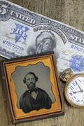 Stock Photo of Men and money in time
