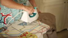 Woman ironing her husband pants Stock Footage