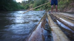 Bamboo raft flowing through the pai river in Maehongson, Thailand Stock Footage