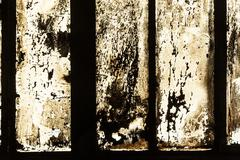 Grungy window with carbon black symbolizes the dirt of iron works factories Stock Photos