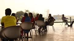 Silhouette of people at restaurant Stock Footage