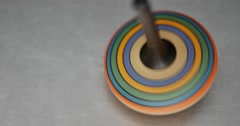 A colorful spinning top on a metal table Stock Footage