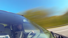Driving a car, camera aimed at the driver through the windshield. Timelapse. Stock Footage