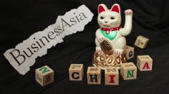 LUCKY ASIAN CAT - with news headline reading 'Business Asia' - stock footage
