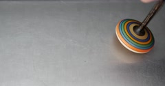 A spinning top being spinned but it failed Stock Footage